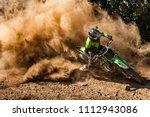 motocross rider creates a huge...   Shutterstock . vector #1112943086