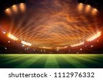 lights at night and football... | Shutterstock . vector #1112976332