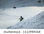 skier with a green and black... | Shutterstock . vector #1112989268
