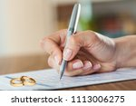 hands of wife  husband signing... | Shutterstock . vector #1113006275