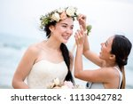 cheerful bride at the beach | Shutterstock . vector #1113042782