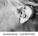 elderly woman wearing a hearing ...   Shutterstock . vector #1113047642