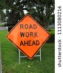 Small photo of Road Work Ahead Sign