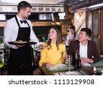 frendly waiter is giving order... | Shutterstock . vector #1113129908