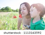 a boy is looking at a flower. a ...   Shutterstock . vector #1113163592