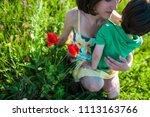 mother hugs the boy. a woman is ...   Shutterstock . vector #1113163766