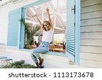elegant barefooted girl sitting ...   Shutterstock . vector #1113173678