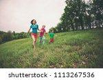 a woman with children runs...   Shutterstock . vector #1113267536
