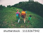 a woman with children goes...   Shutterstock . vector #1113267542