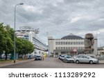 Small photo of GDYNIA / POMERANIAN REGION - POLAND - 2018: Historic Passenger Sea terminal with a Museum of Emigration and Cruise Ship SAPPHIRE PRINCESS at the wharf