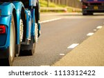 a closeup of wheels in motion... | Shutterstock . vector #1113312422