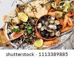 sea food plate in portugal  ... | Shutterstock . vector #1113389885