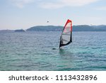 unidentified surfer on the...   Shutterstock . vector #1113432896