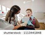 little boy at dentist chair.... | Shutterstock . vector #1113441848