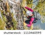 people climbing on steep rock...   Shutterstock . vector #1113460595