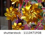 Small photo of Selected focus gold paper turbines fortune at Che Kung Temple (Windmills temple), Hong Kong