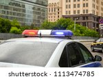 police car with flashing light... | Shutterstock . vector #1113474785