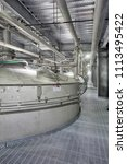 Small photo of Pocatello, Idaho, USA July7, 2017 A high tech stailnless steel tank with ventilation ducting in a clean, modern barley malt processing facility.