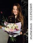 woman florist gloved holding...   Shutterstock . vector #1113522605