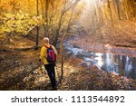 hiking outdoors in autumn forest | Shutterstock . vector #1113544892