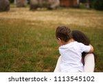 mom hugs baby in the park   Shutterstock . vector #1113545102