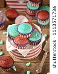 cupcakes red and blue velvet on ... | Shutterstock . vector #1113571736