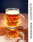 delicious beer in a glass of...   Shutterstock . vector #1113576275