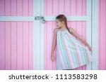 adorable little girl outdoors... | Shutterstock . vector #1113583298