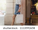 attractive woman doing shopping.... | Shutterstock . vector #1113592658