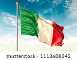 italy flag on the blue sky with ... | Shutterstock . vector #1113608342