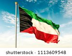 kuwait flag on the blue sky... | Shutterstock . vector #1113609548