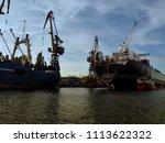 dockyard with heavy freight... | Shutterstock . vector #1113622322