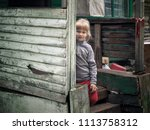 Stock photo portrait oportrait of a village little girl the porch of the old housef a village little girl the 1113758312