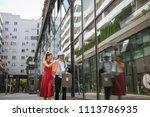 happy elegant couple carrying... | Shutterstock . vector #1113786935