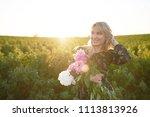 cute young blonde girl spends... | Shutterstock . vector #1113813926