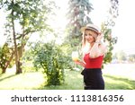 young pretty blonde spends time ... | Shutterstock . vector #1113816356