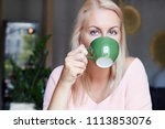 shot of happy female with blond ... | Shutterstock . vector #1113853076