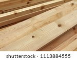 Rough sawn Scots pine boards stack on the construction site