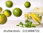 lemon drink on the wooden table. | Shutterstock . vector #1113888722