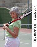 Senior Playing Tennis - stock photo