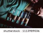 preparation of shots cocktails. ... | Shutterstock . vector #1113989036