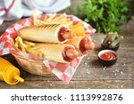 french hot dog with ketchup ... | Shutterstock . vector #1113992876