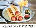 french hot dog with ketchup ... | Shutterstock . vector #1113992882