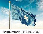 somalia flag on the blue sky... | Shutterstock . vector #1114072202