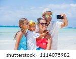 family of four making selfie... | Shutterstock . vector #1114075982