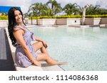 pretty hispanic woman dipping... | Shutterstock . vector #1114086368