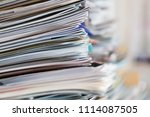 papers stacked randomly   Shutterstock . vector #1114087505
