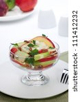 Closeup of blue cheese - pecan apple salad with apples, blue cheese, parsly and pecan nuts served for healthy lunch - stock photo