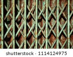 teal color old rusty folding... | Shutterstock . vector #1114124975
