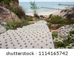 sea view from on stone walkway | Shutterstock . vector #1114165742